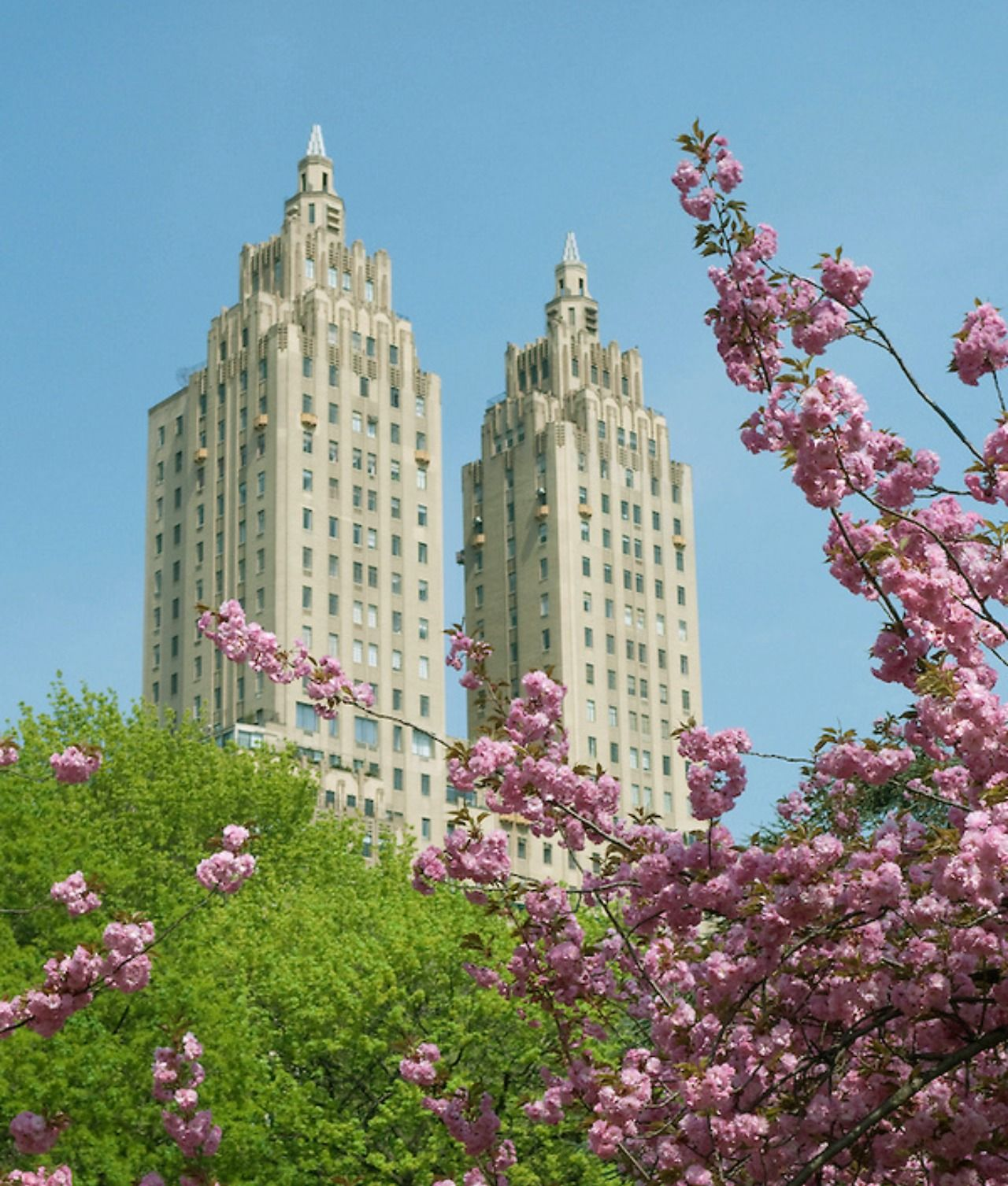 Cherry blossoms in Central Park and The El Dorado, Central Park West, New York City. Designed by Margon & Holder, 1931