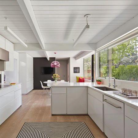 Dark Wood Ceiling skylights and white painted panelling light bright home dark wood