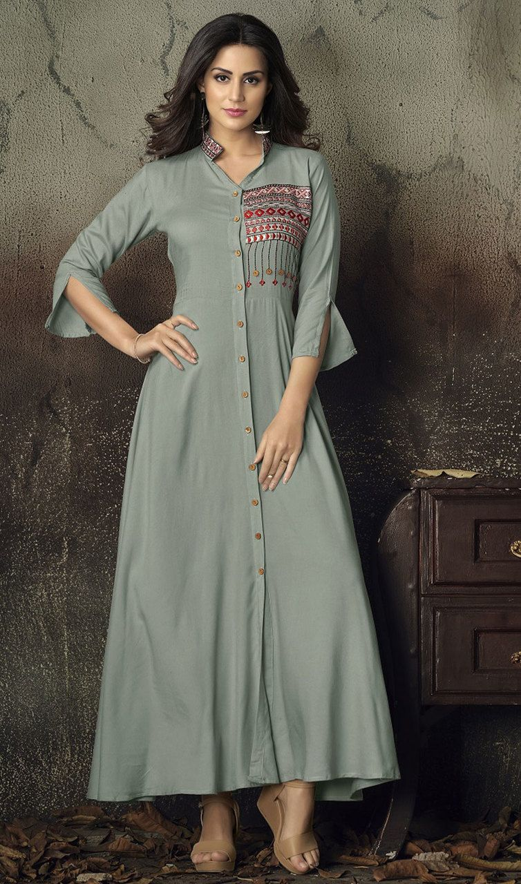 ec4c846064 #asianbridalgowns #indianweddinggown Unfold your sartorial elegance donned  in this gray color shaded rayon gown