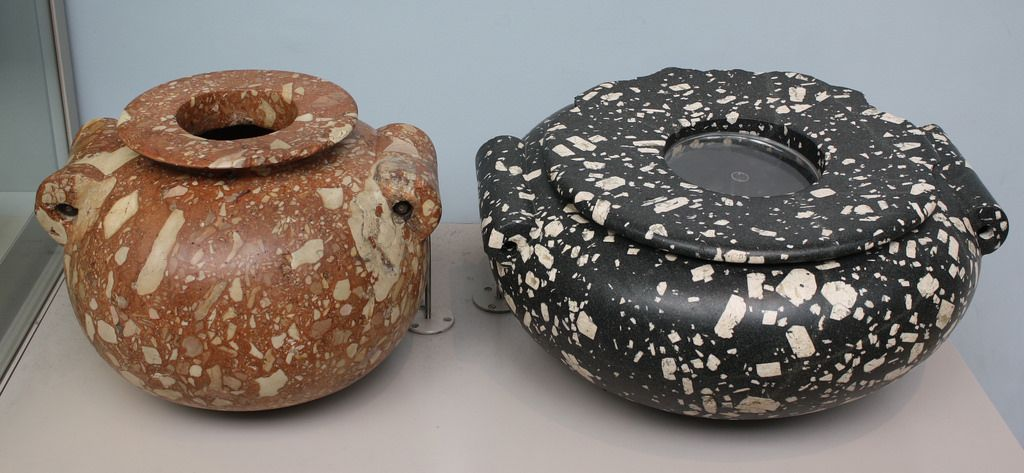 A Pair of Massive Egyptian Early Dynastic Limestone Breccia and Andesite Porphyry Jars, Among the Largest Examples Known   by Ancient Art & Numismatics