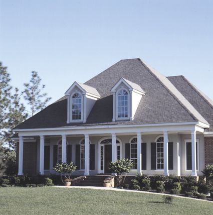 Lovely 4 bedroom southern style home with front columned for House plans with large front windows