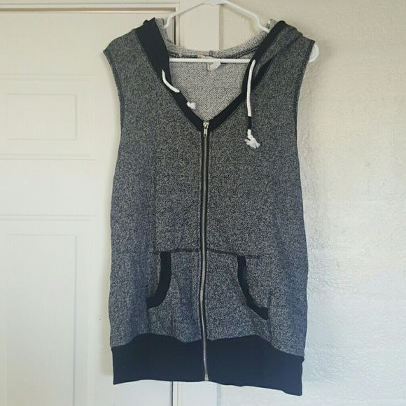 V-Neck Vest Super cute sporty vest needs a new home!  Never worn just tried on.  Has a Hood and 2 pockets in the front.  The pockets aren't too deep.  Great condition Level Eight Jackets & Coats Vests