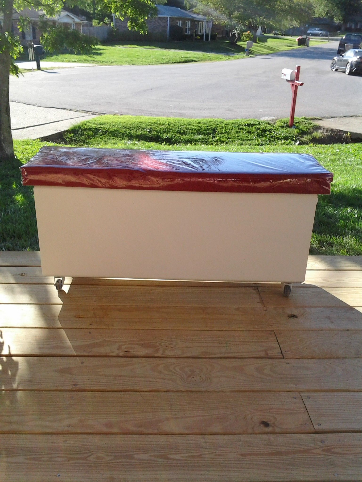 Storage bench made from an old speaker box I added casters and