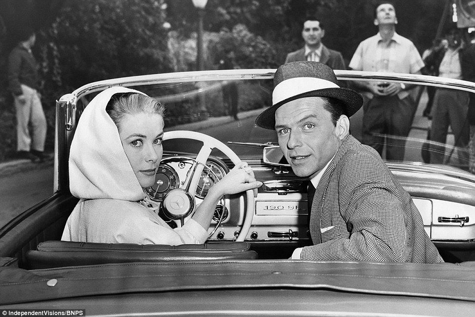 Sinatra poses with Grace Kelly on the set of High Society in 1956. Even though he is more ...