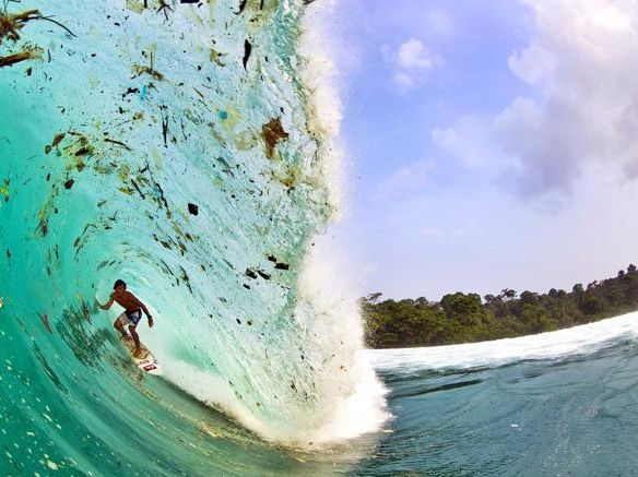 Shocking images of surfer surrounded by garbage
