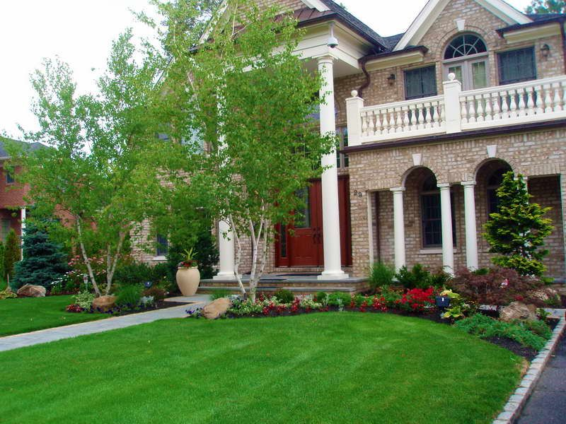 Landscaping Ideas On The Budget Front Yard With White Column Stand