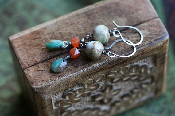 Feature a delicate and meticulous handwoven wire basket embracing the top of the blue Opal stone that dangles bellow a 3D Carnelian earrings and a