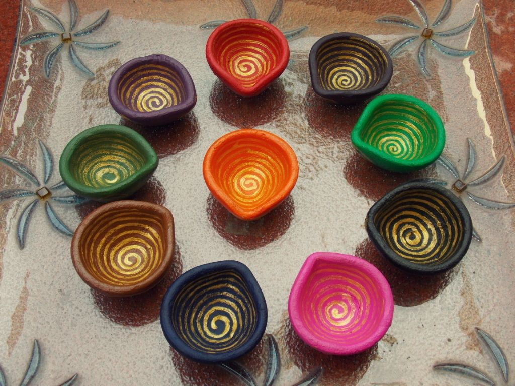 Diyas! Traditional Indian diyas with golden spiral design