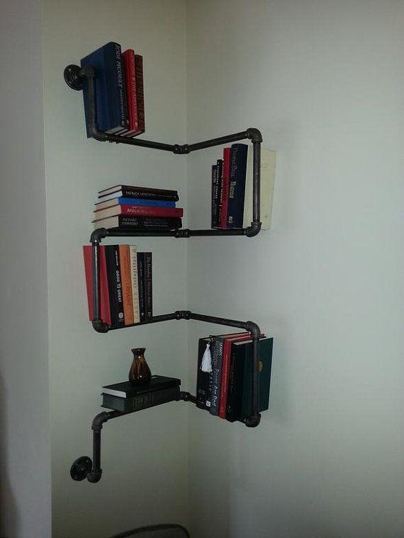 Black iron pipe wall mounted corner book shelf by