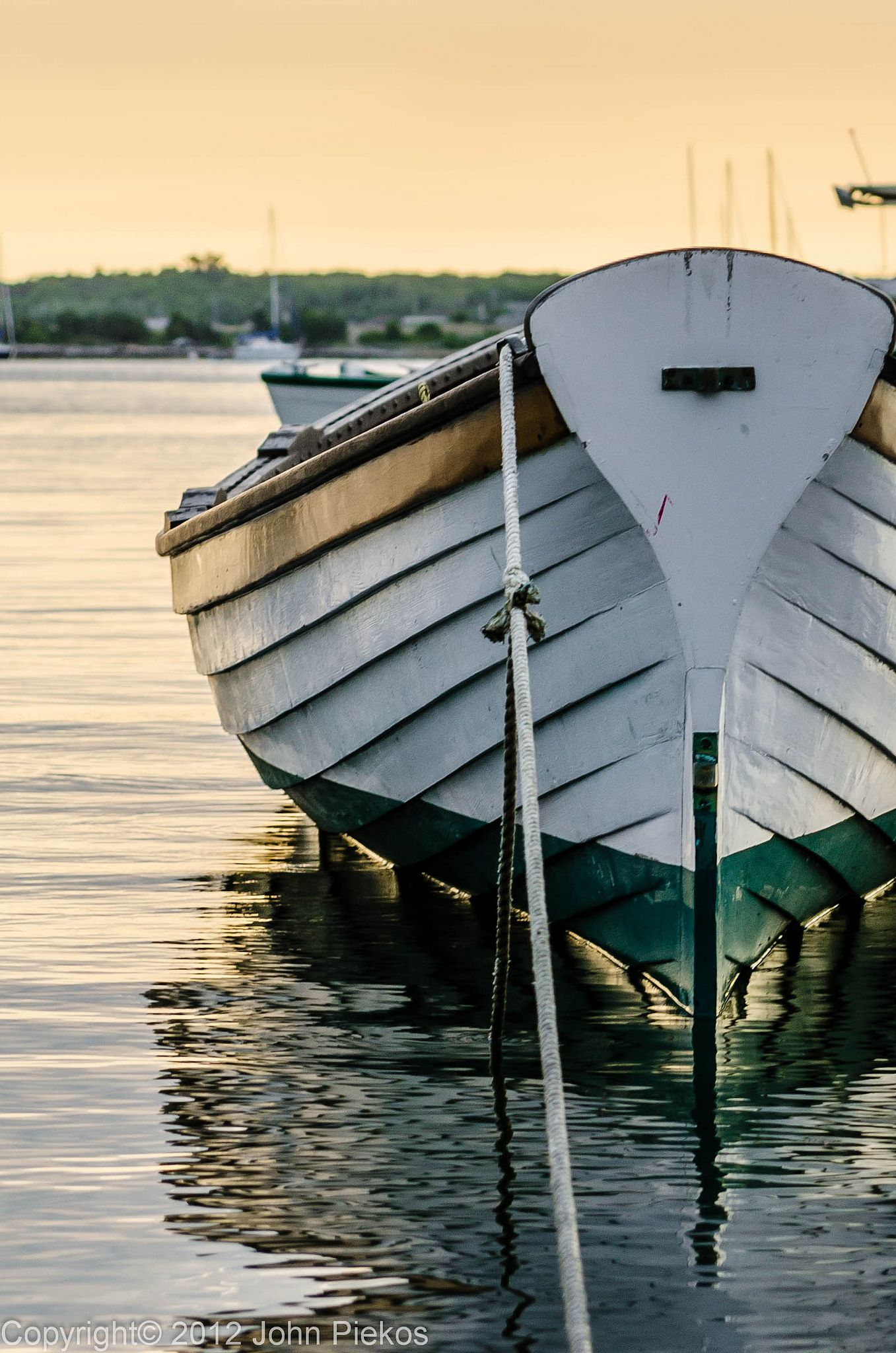 The Row Boat | One of the row boats in Vineyard Haven Harbor on Martha's Vineyard.  Most mornings a group of people take this boat out as some sort of group or team paddling workout.