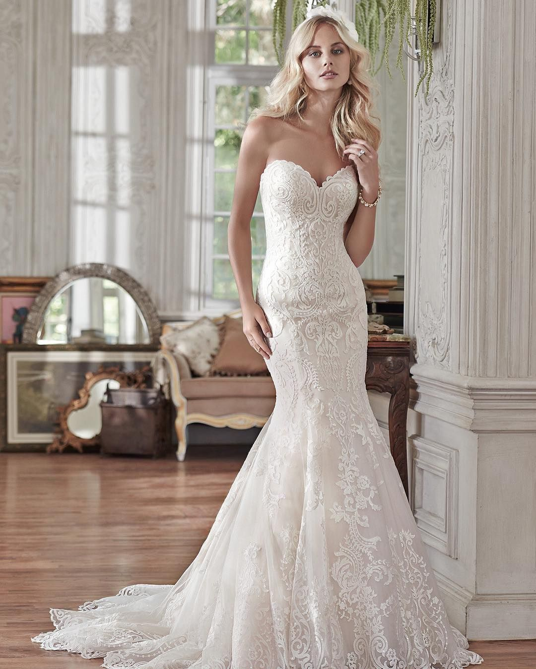 Free wedding dress catalogs  fsnewarrivals  We adore the detailing of this bold lace appliqué
