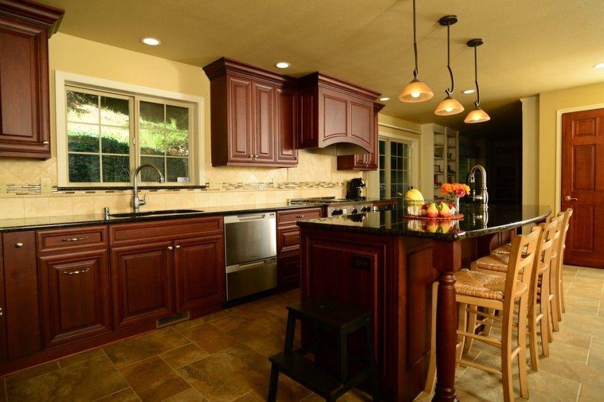 25 remarkable kitchens with dark cabinets and dark granite for Dark cabinets light granite
