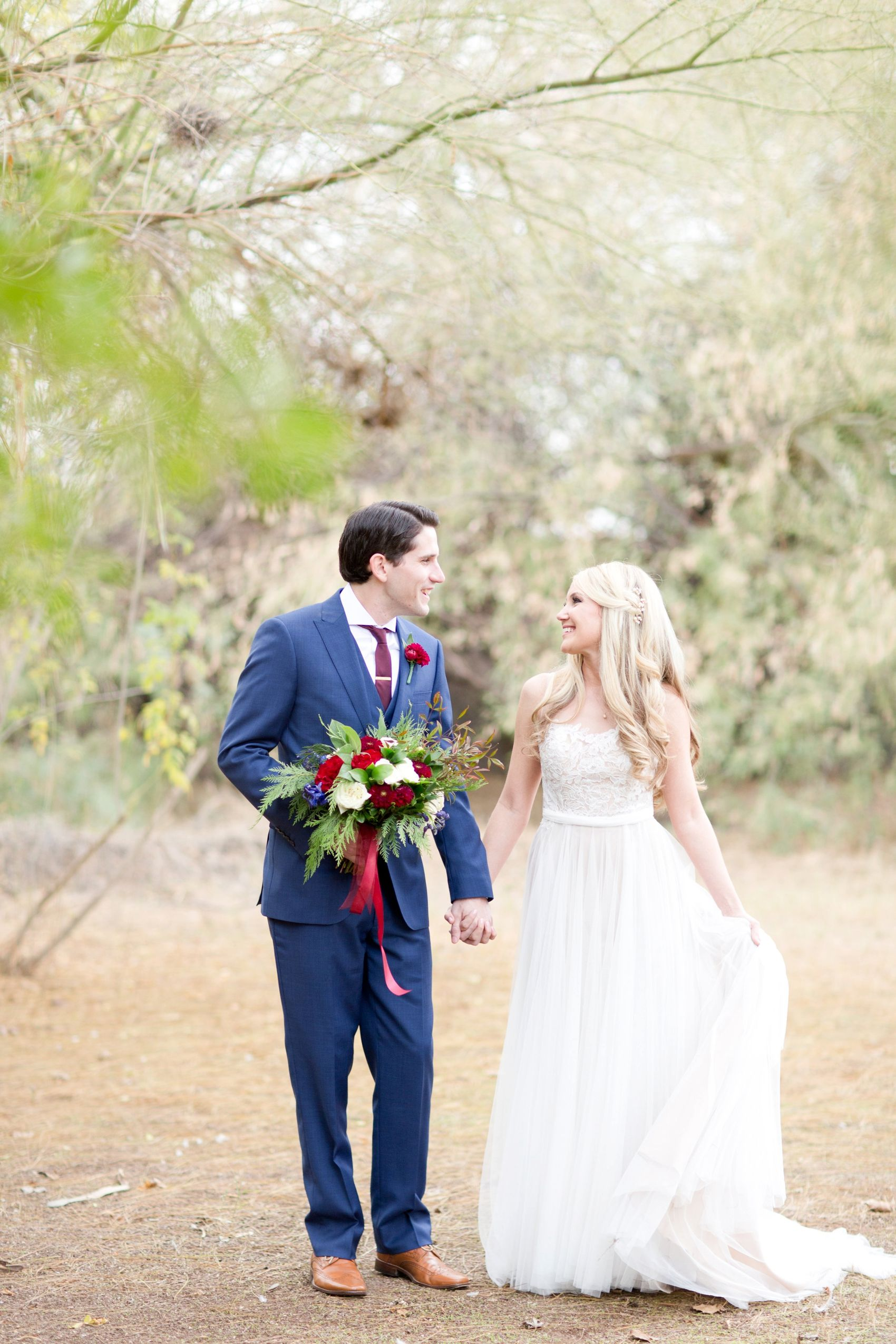 36c5c6ac9e A Secret Garden wedding in Burgundy and navy. Lace and chiffon dress tied  with a satin bow in the back. Luscious natural florals.