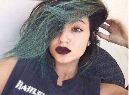 Kylie jenner, wearing dark red lipstick