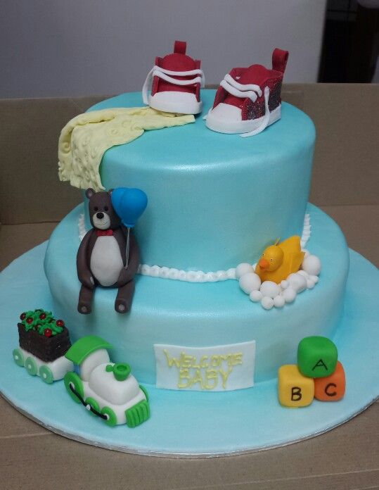 """Welcome baby"" baby shower cake with handmade fondant figurines"