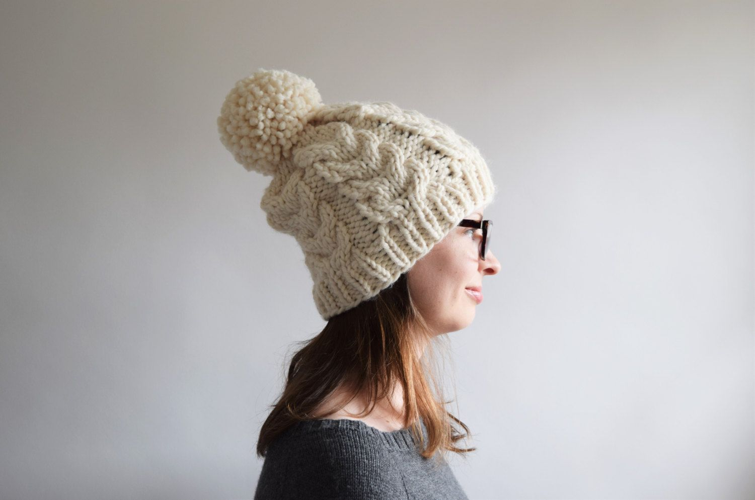 Keep warm this winter with a cabled pom pom hat! The chunky cables ...