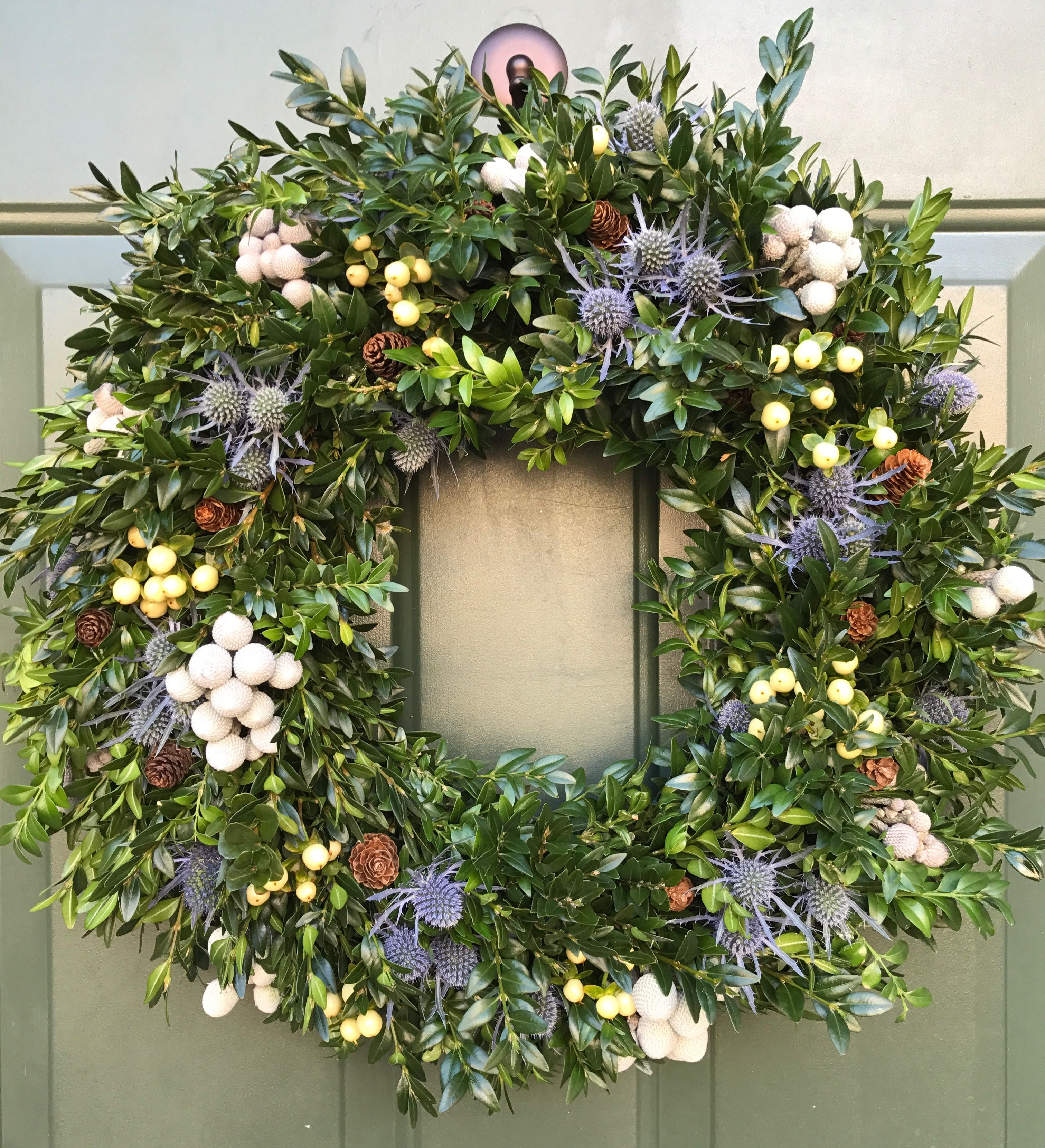Holiday door wreath with fresh boxwood, white hypericum