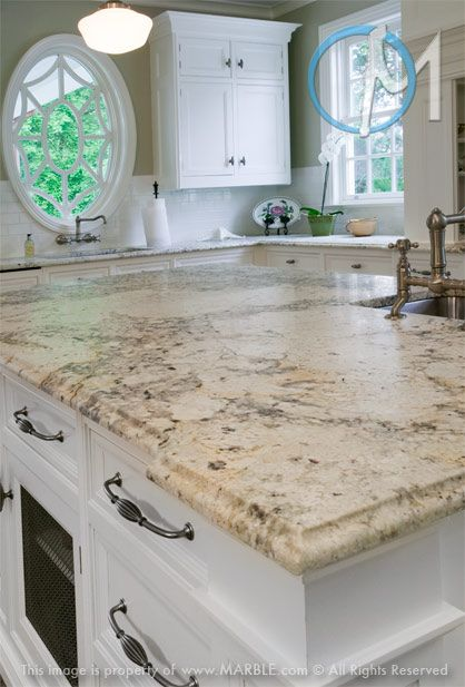 The Attractive Veining In Bianco Romano Granite Makes For An Interesting Island Countertop