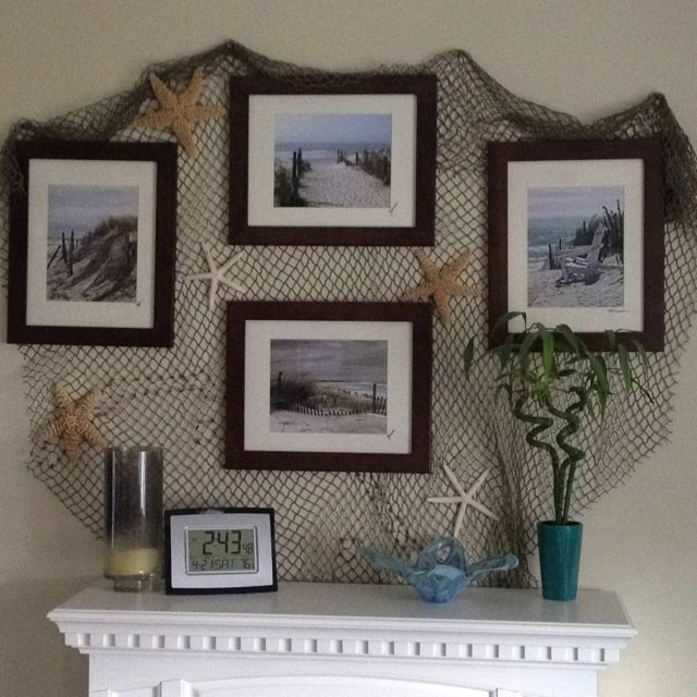 Fish net, a few star fish, and framed photos of beach