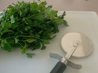 Use a pizza cutter to chop herbs.  Now why didn't I think of that?!?