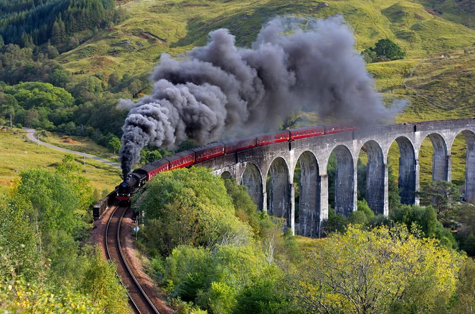 Glenfinnan Viaduct is a railway viaduct on the West Highland Line in Glenfinnan, Lochaber, Highland, Scotland. It was built between July 1897 and October 1898 at the cost of £18,904. Located at the top of Loch Shiel in the West Highlands of Scotland, the viaduct overlooks the Glenfinnan Monument and the waters of Loch Shiel. You can board the Jacobite train, used as the Hogwarts Express in the films. Travel on board the steam train to Mallaig over the stunning Glenfinnan Viaduct.