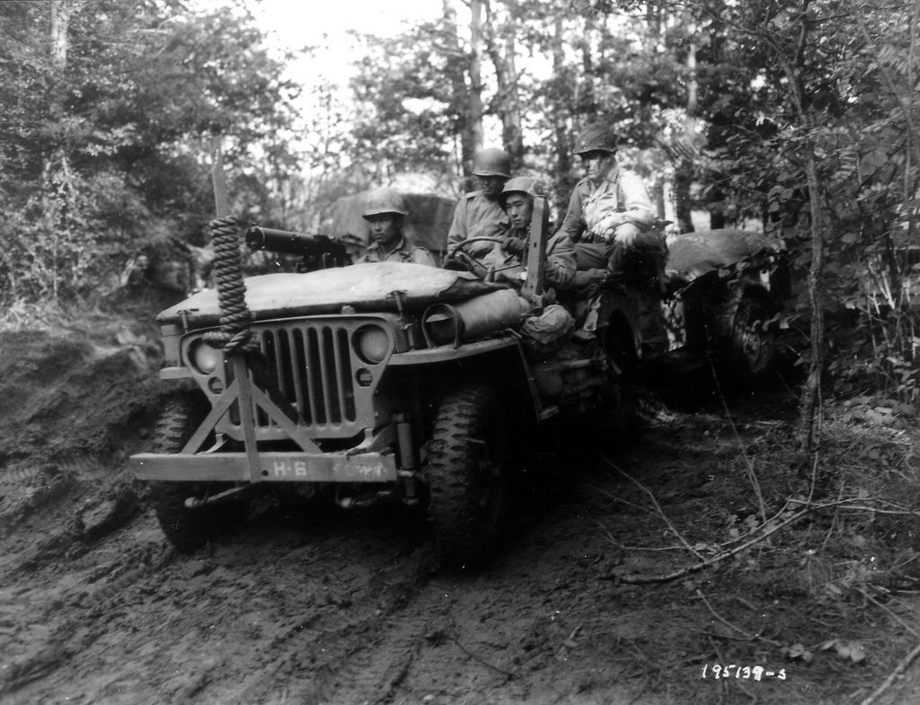 In a forest, a Jeep with three GI\'s of Japanese origin and an ...