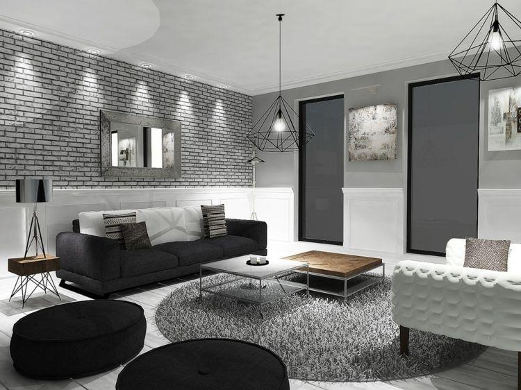 Wohnzimmer mit filigranen Pendelleuchten und schicken Möbeln