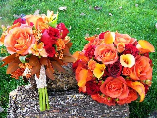 Bride and bridesmaid in fall callas, roses and alstromeria.   Floral Designs by Jodi