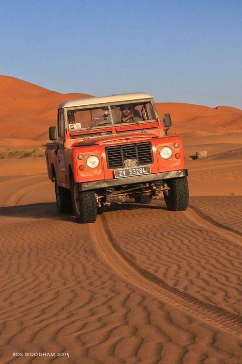 Land Rover Defender on The red desert. App for Land Rover
