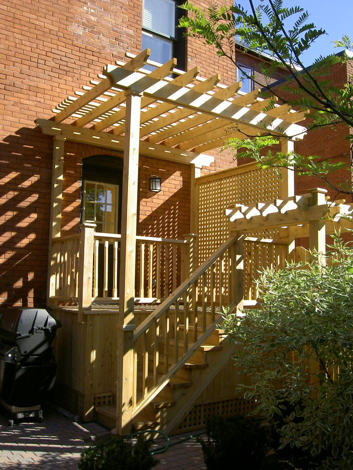 A lovely cedar deck with pergola top along with detailed railing