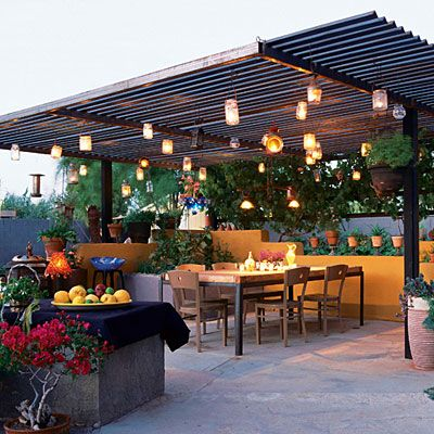 """Summer Lights from Mason Jars, etc - In his backyard ramada in Scottsdale, Arizona, artist Jeff Zischke houses candles in antique carriage lamps and ordinary mason  jars; he supplements their glow with low-voltage lamps.""""There's still no substitute for candlelight,"""" he says. """"That flickering glow just draws people in like moths."""""""