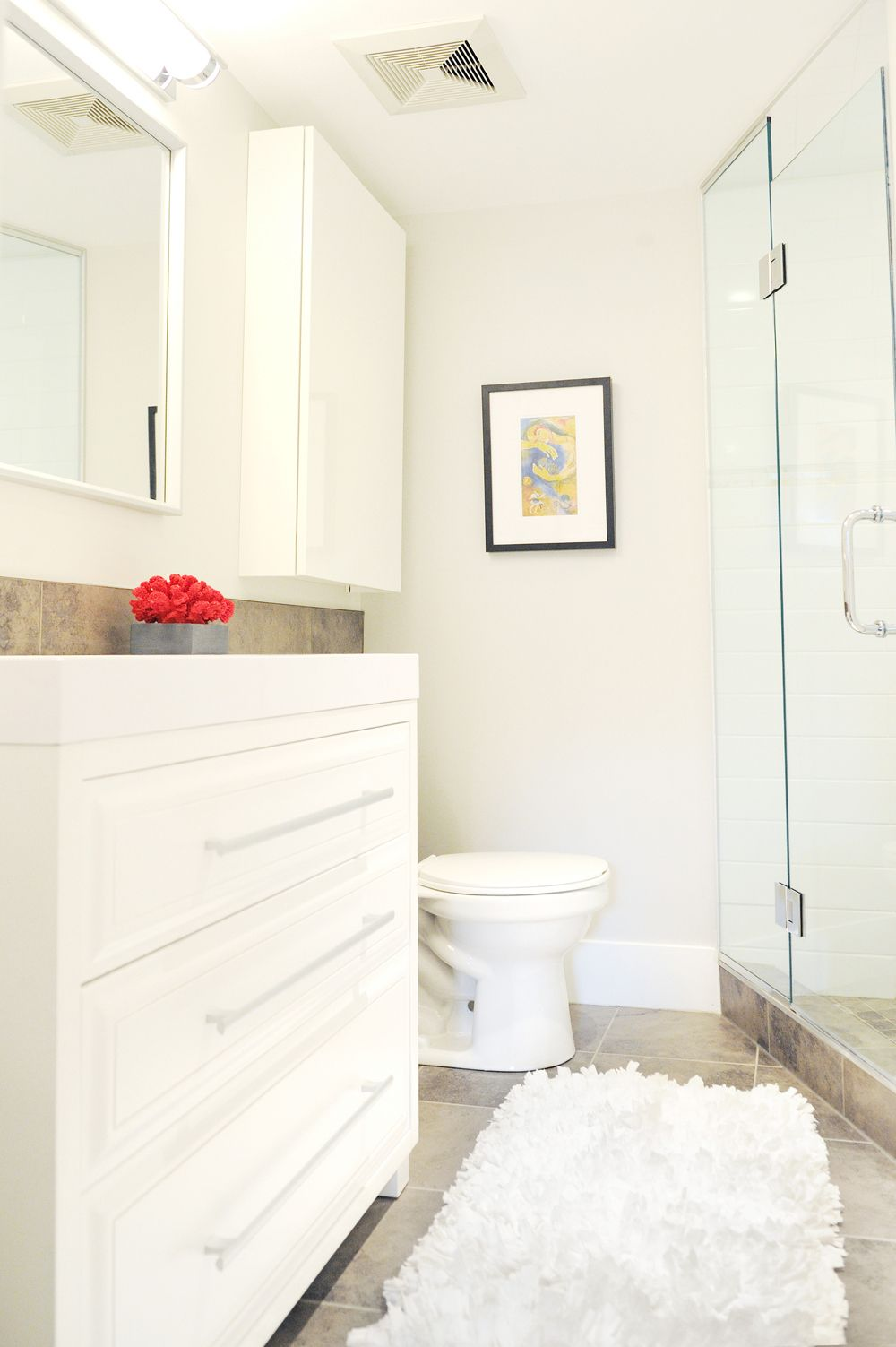 modern, clean, white & grey small space, bathroom, pops of red ...