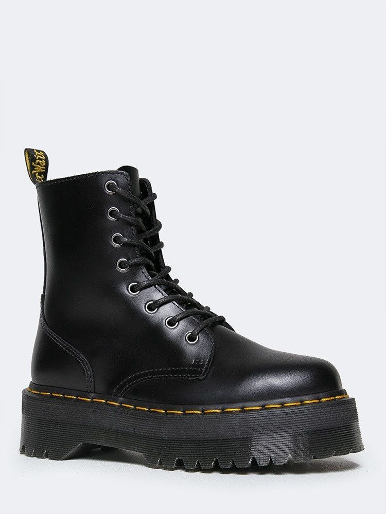 37beb3767ca1c Take on the day with classic Doc Martens! - This quality black ankle boot  is made with a polished smooth leather, laces up the front and yellow  stitching at ...