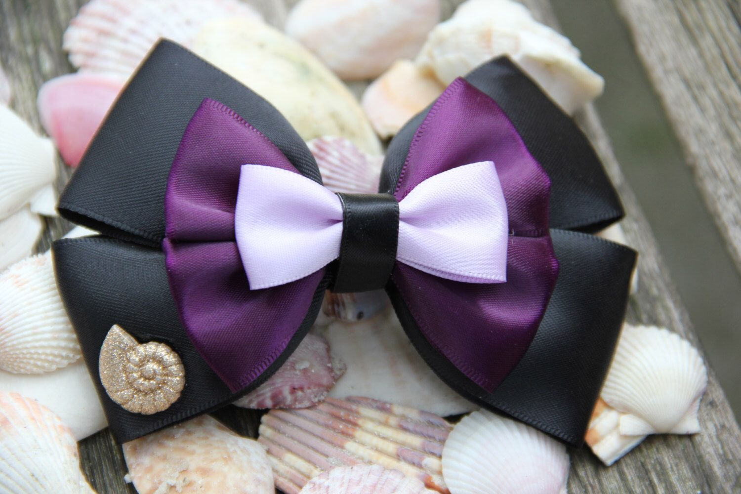 Ursula Hair Bow by DumbowShoppe on Etsy https://www.etsy.com/listing/201160078/ursula-hair-bow