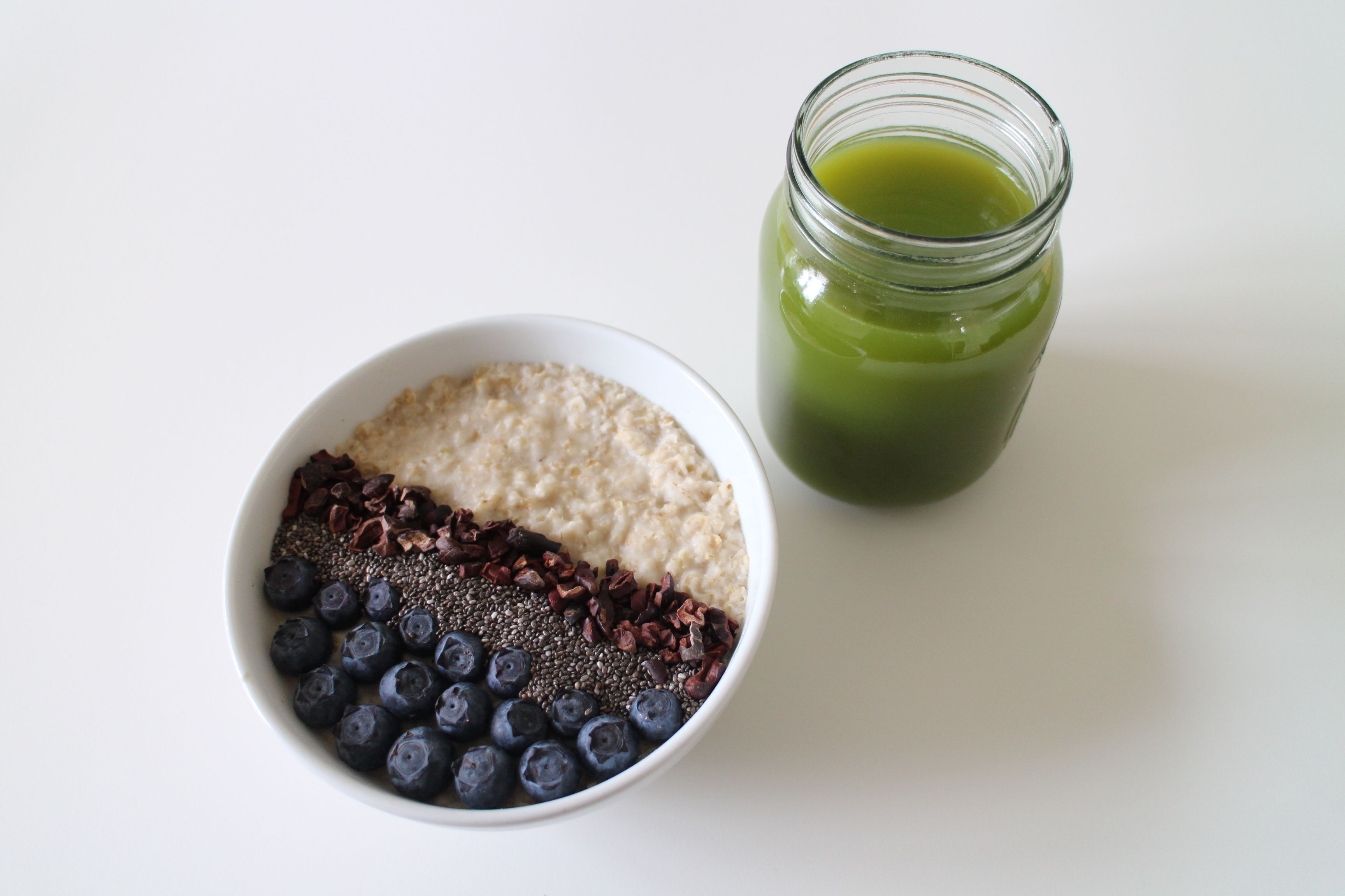 """Breakfast is our favourite meal of the day here at Jurlique so we love this porridge combination shared by the-nutritionista.co.uk  """"I have used almond milk, baobab powder & have topped with blueberries, chia seeds & raw cacao nibs with a side of green juice. So delicious and packed full of goodness."""""""