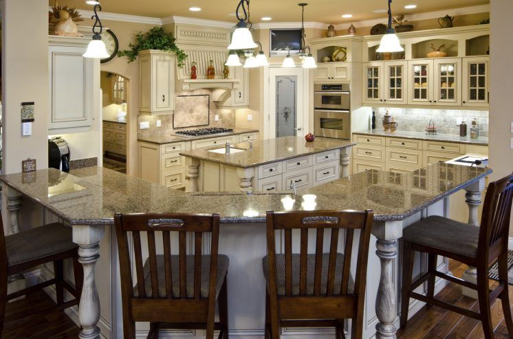 Riveting Large Curved Kitchen Island With Granite Counter Top