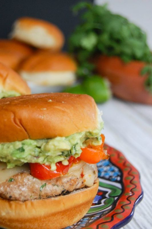Sweet and Spicy Turkey Burgers with Guacamole are perfect for tailgating season. These turkey burgers combine ground turkey, spices, roasted mini sweet peppers, spicy pepper jack cheese and creamy guacamole sandwiched between King's Hawaiian's Hamburger Buns. // A Cedar Spoon #ad