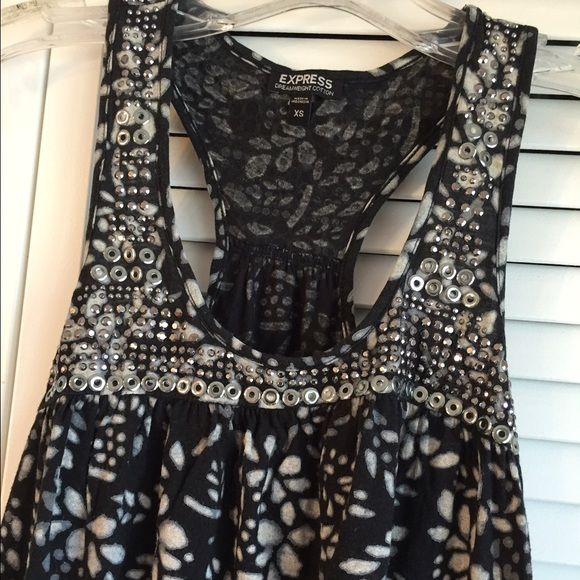Embellished Racerback Top Black and white floral printed racerback top with beaded embellishments on front and back.  In good condition! Express Tops Tank Tops