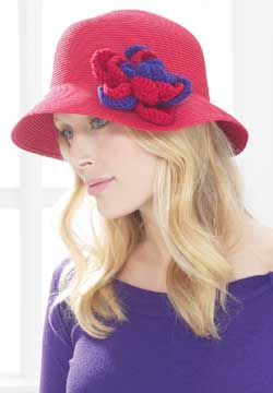 Live loudly with this decadent red and purple hat pin.