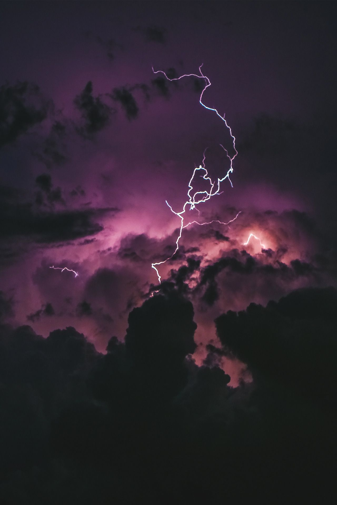 Purple lightning dancing with the night clouds (With
