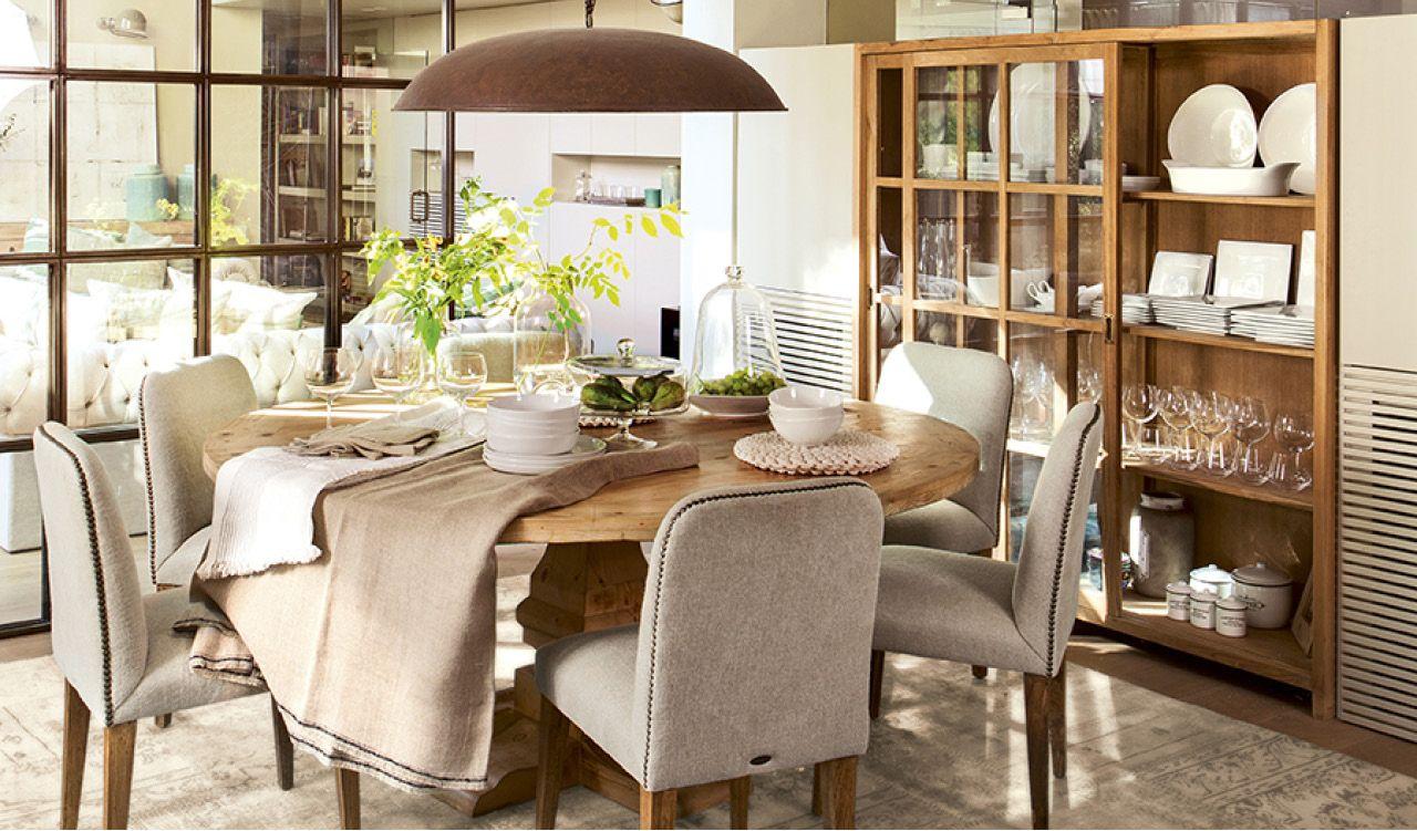 En el comedor mesa de mercantic sillas de lucio alfombra for Lamparas de mesa maison du monde