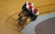 Britain's Philip Hindes, Chris Hoy and Jason Kenny compete in the track cycling men's team sprint qualifying heats at the Velodrome during the London 2012 Olympic Games August 2, 2012. Team Britain set a new Olympic record of 43.065 seconds in their heat. REUTERS/Paul Hanna