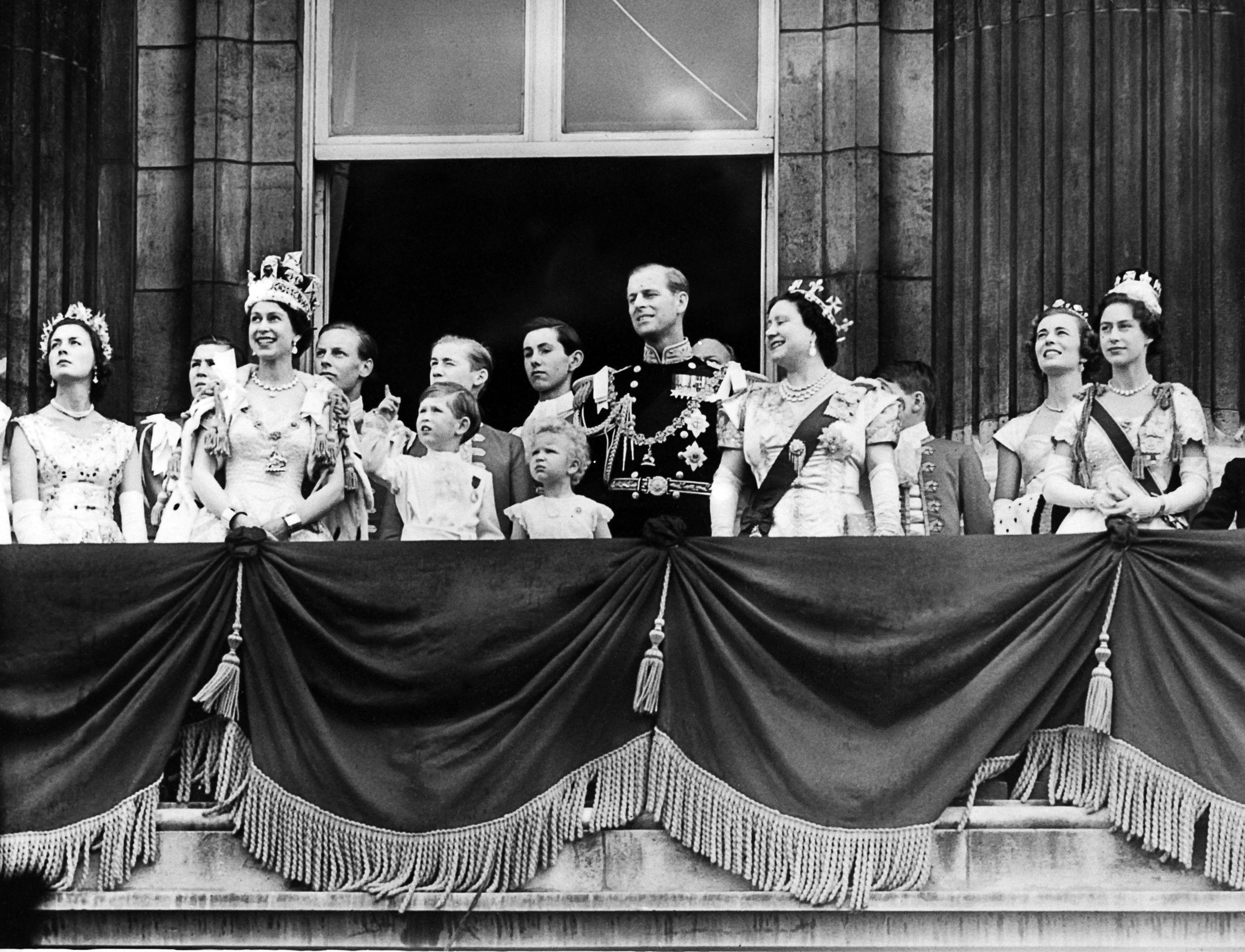 Britain's Queen Elizabeth II (2nd L), by