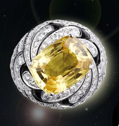 Cartier's Solar Collection - Ring, white gold, one 12.40-carat cushion-shaped yellow sapphire, black lacquer, brilliant-cut diamonds.