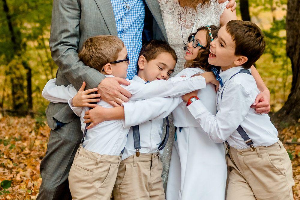 Wedding photo ideas with kids Family hug with bride