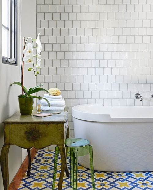 I'm actually liking the patterned tile on the floor and I like how the entire back wall is tiled.