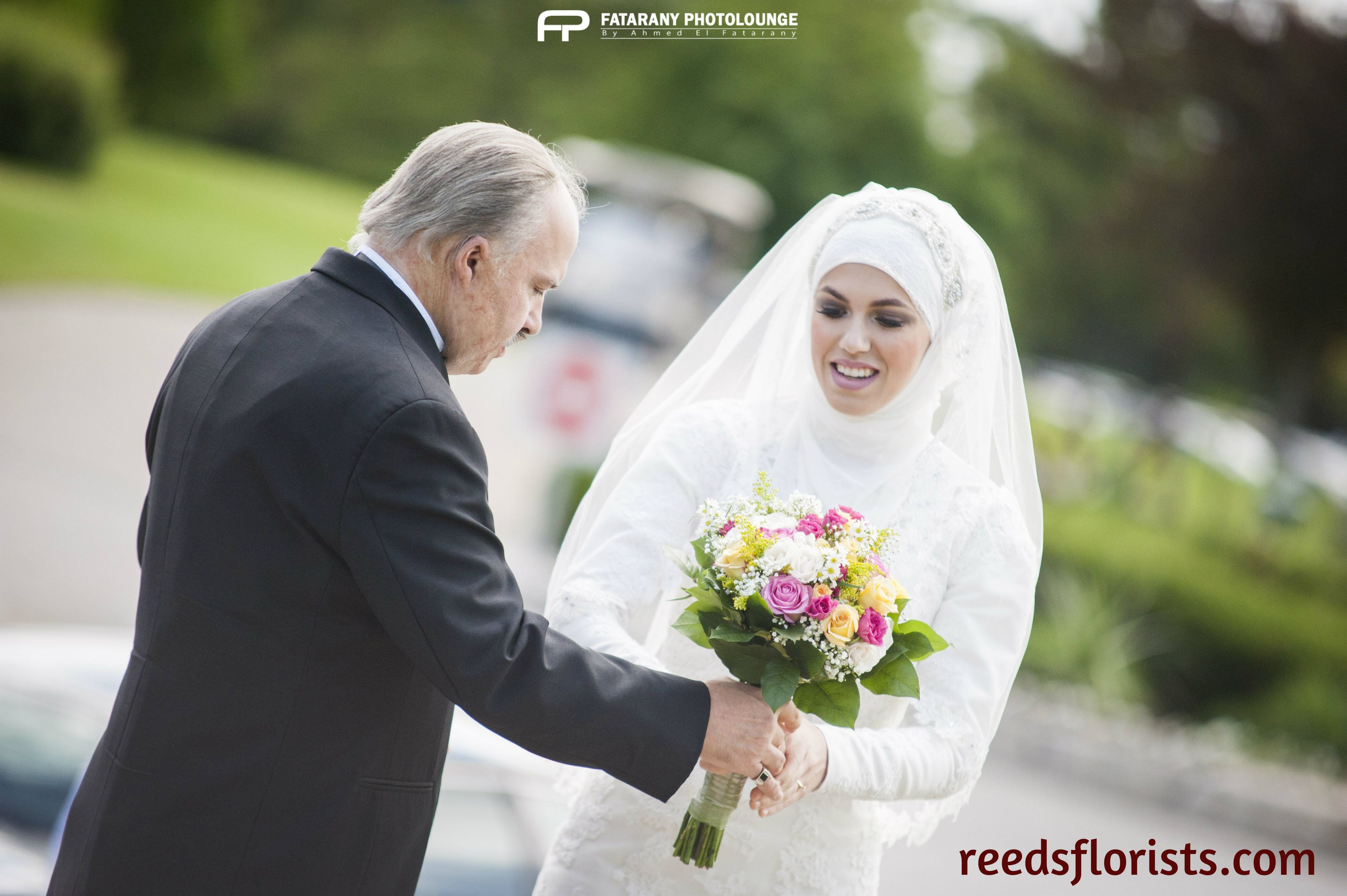 Dad hands his beautiful daughter her pretty bouquet. Flowers by www.reedsflorists.com photography by Fatarany Photolounge