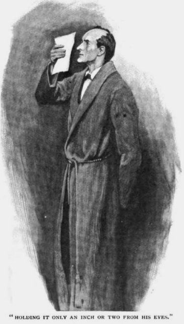 Sherlock Holmes The Hound of the Baskervilles holding it only an inch or two from his eyes