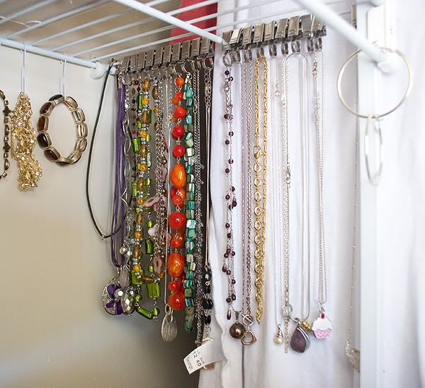 Necklaces hung from Ikea curtain clips