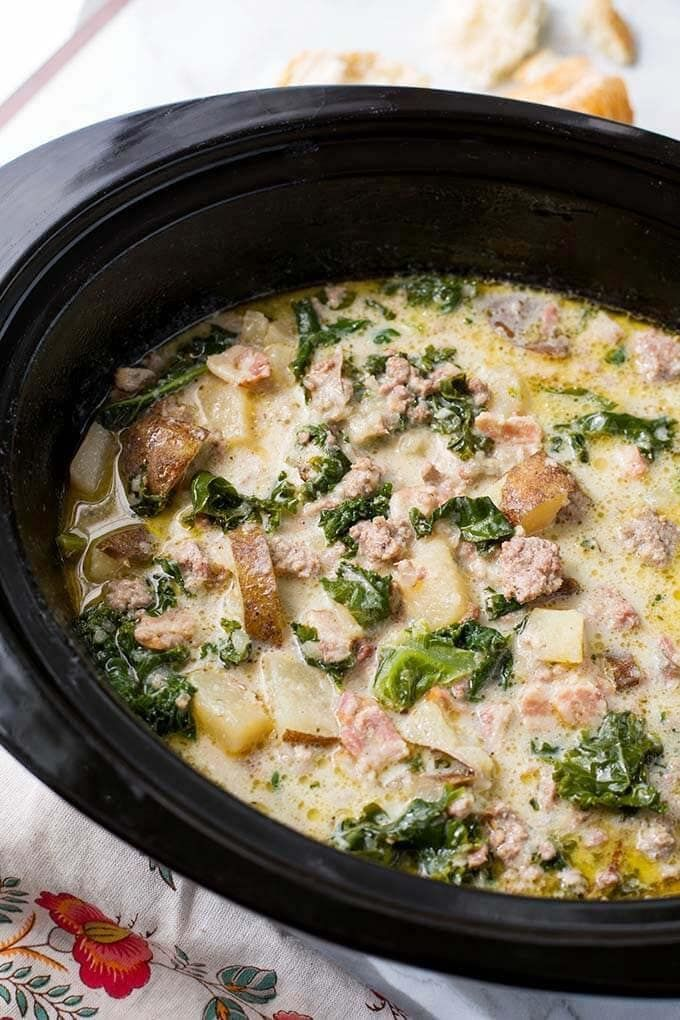 Crock Pot Zuppa Toscana Sausage Potato Soup is rich and very flavorful. With sausage, potatoes, bacon, & kale. A tasty, easy slow cooker zuppa Toscana soup. simplyhappyfoodie.com #crockpotzuppatoscana #crockpotsausagepotatosoup #slowcookerzuppatoscana #slowcookersausagepotatosoup #olivegardensoup #sausagepotatoes Crock Pot Zuppa Toscana Sausage Potato Soup is rich and very flavorful. With sausage, potatoes, bacon, & kale. A tasty, easy slow cooker zuppa Toscana soup. simplyhappyfoodie.com #crock #zuppatoscanasoup